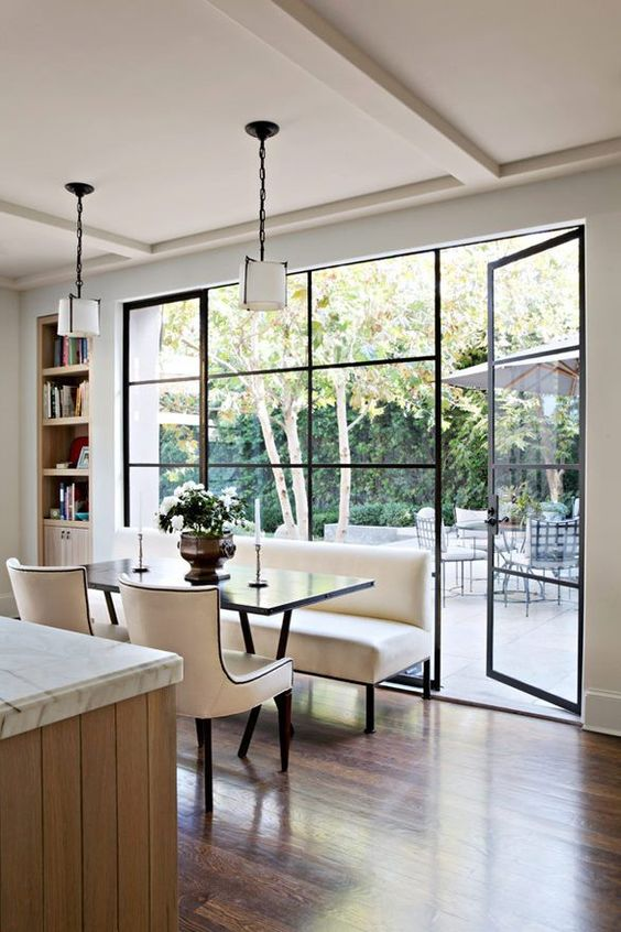 Image of large windows in a dining room.