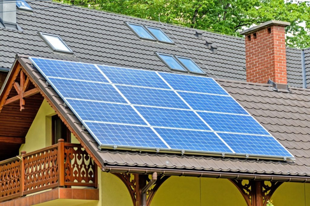 Image of solar panels ont he roof of a house.