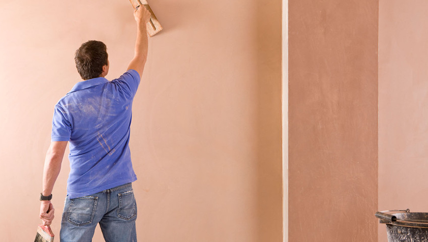 plastering a wall