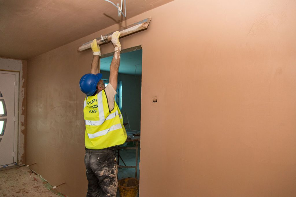 smoothing out the wall plaster